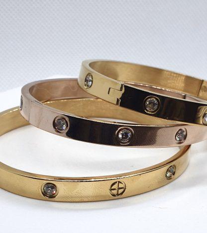 Fragrantly Sparkle Light armband cuffs met zirkonia en sun cross teken